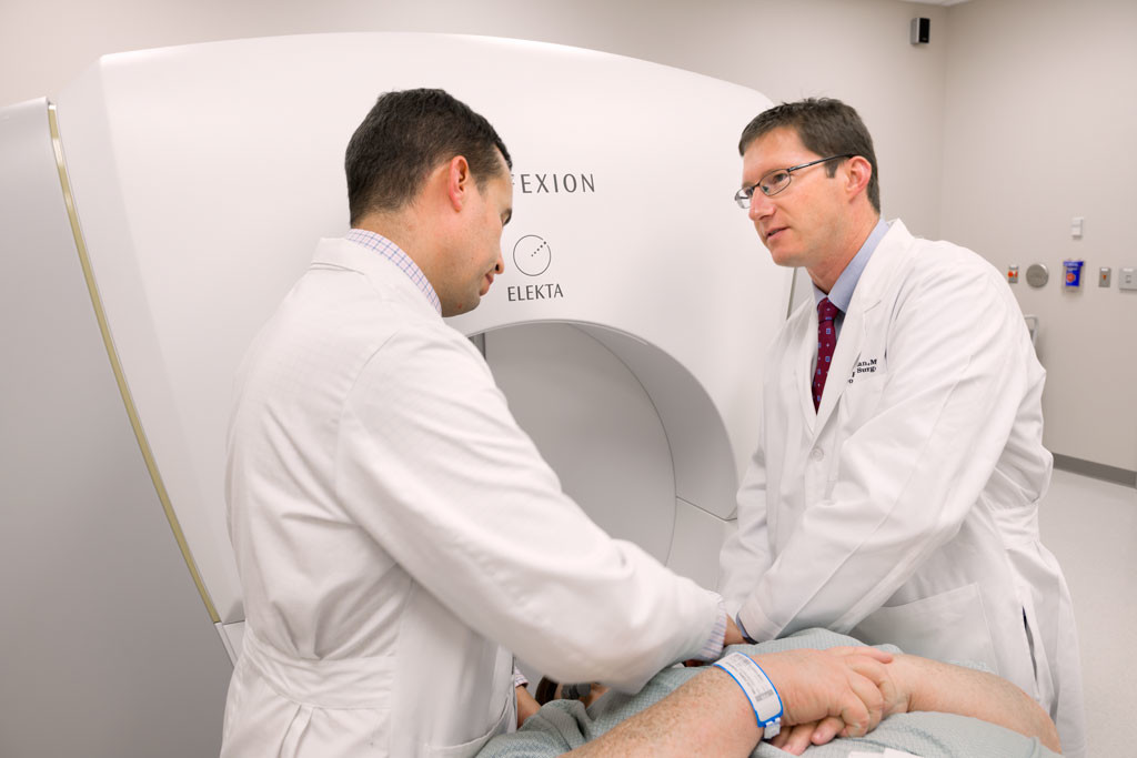 Dr Joel Norman and Joseph Petit, PhD prepare a patient for a procedure in the Gamma Knife Center